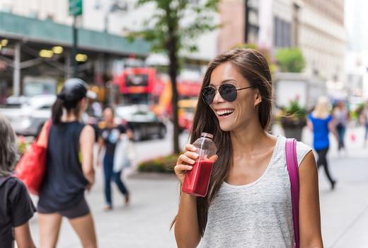 Agavi juice happy woman drinking juice