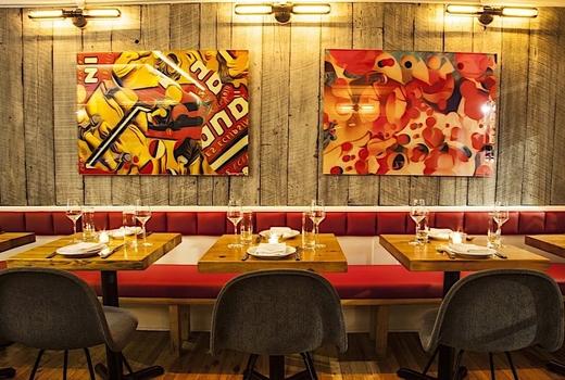 Dia restaurant dinner inside red booths art