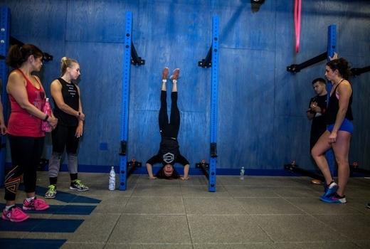 Ice nyc headstand woman