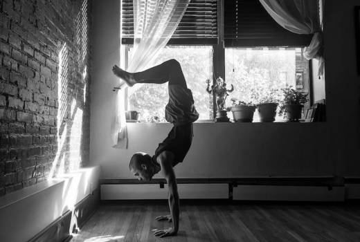 The bhakti center man handstand yoga