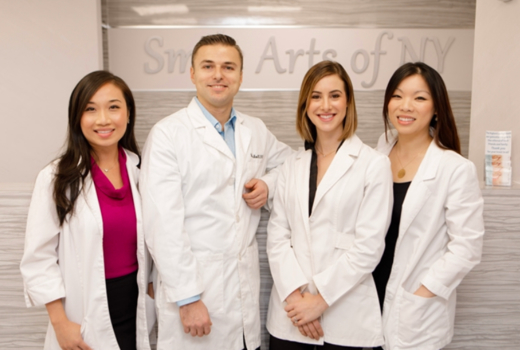 Smile arts dentists team happy