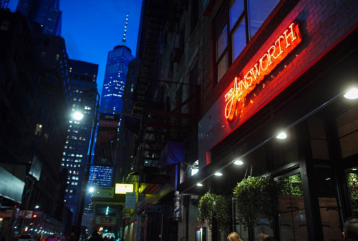The ainsworth fidi brunch outside neon sign freedom tower
