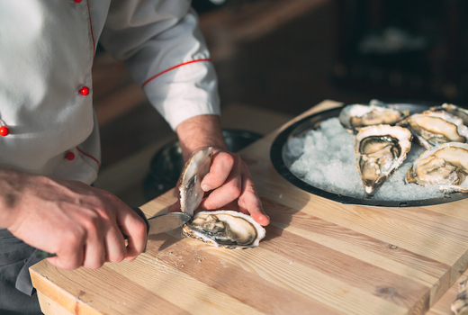 Cara mia oysters chef opening shell