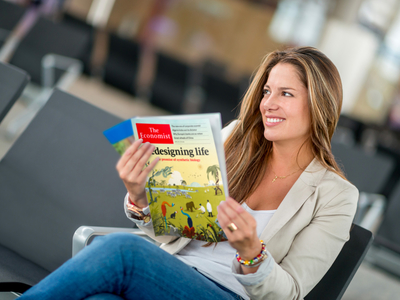 The economist woman reading happy