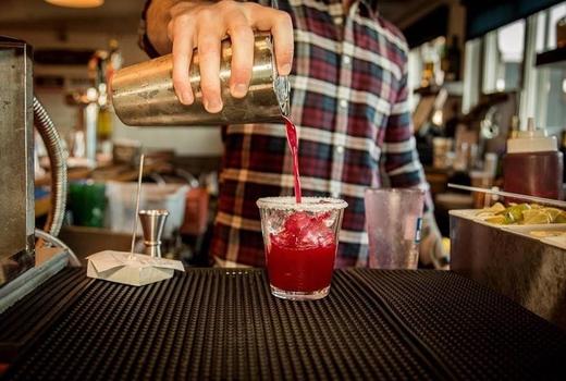 Bungalow luau party bar drink pour