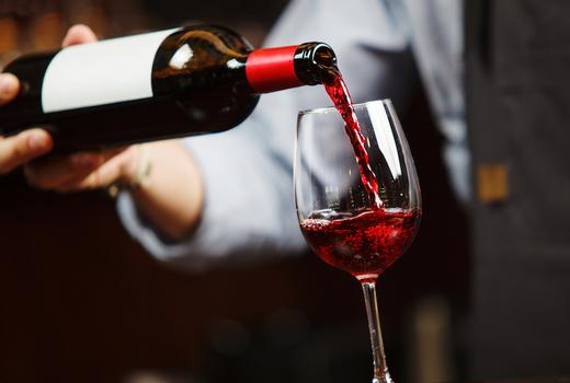 Thalassa red wine bottle pour