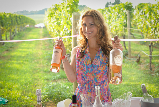 Summer rose bubbly fest woman holding bottles1