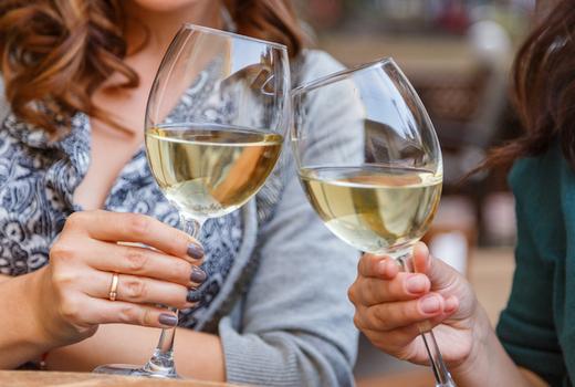 Benares women cheers white wine