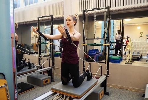 Pilates on fifth woman arm tone