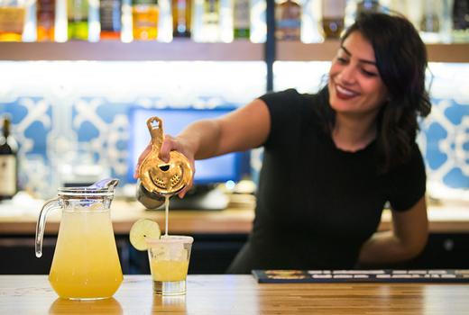 Habanero blues bartender pouring margarita
