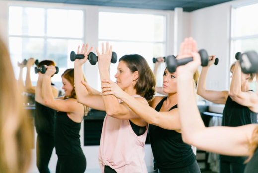 Bar method women working out instructor