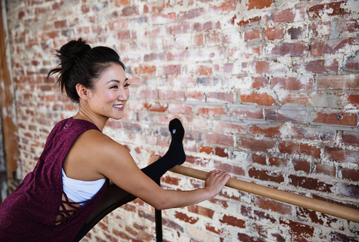 Bar method woman stretching cool