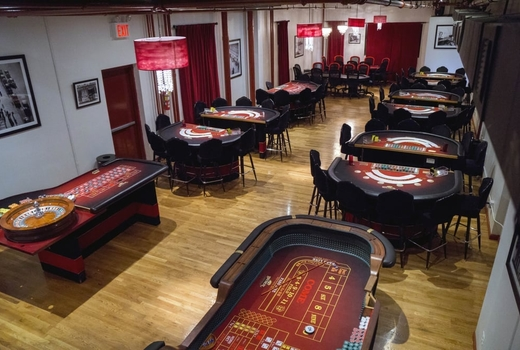 Big deal casino speakeasy party inside room view tables