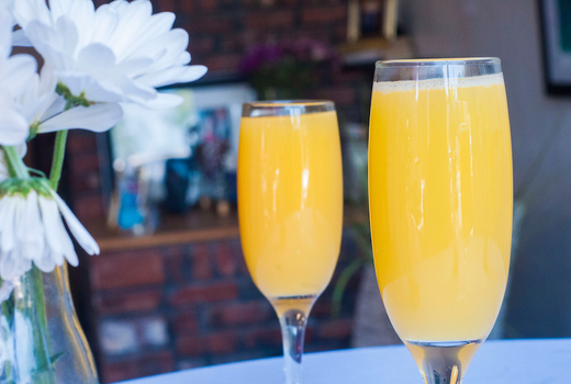 The stand mimosas drink cheers