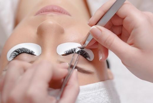 Lash perfection woman applying lashes