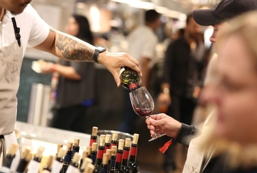 Eataly spring cheese wine festival bottles pour