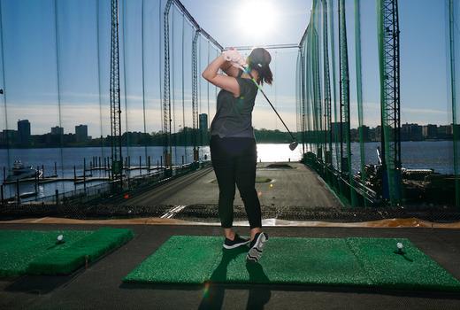 Chelsea piers woman golfing swing