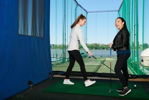 Chelsea piers women fun happy golfing
