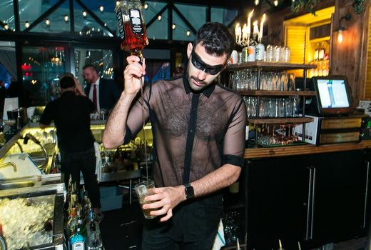 Refinery rooftop halloween bartender pour