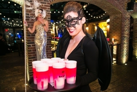 Refinery rooftop masquerade drinks serve