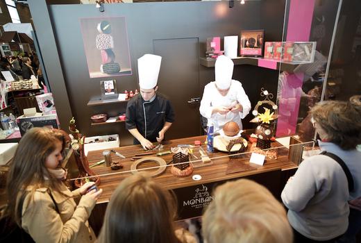 Salon du chocolat vendor making chocolate