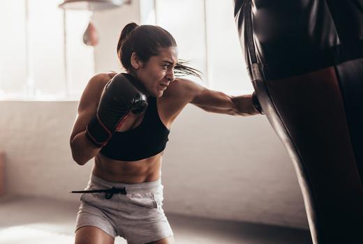 Hudson boxing gym woman hitting bag