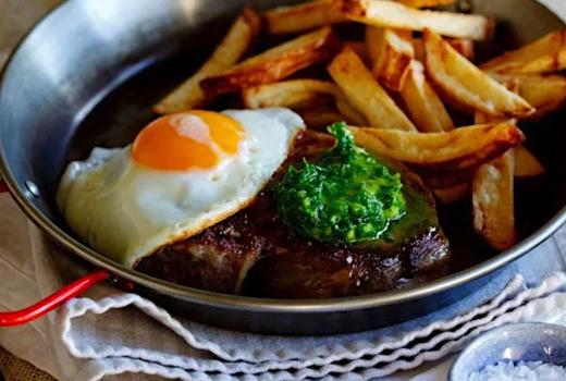 Rooftop exchange fries steak eggs