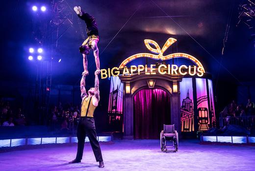 Big apple circus men hold