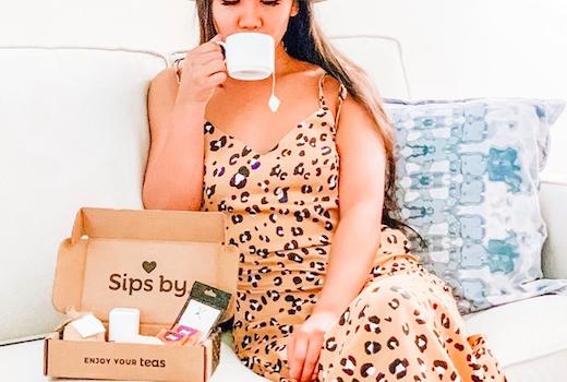 Sips by woman dress