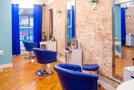 Gc salon hair inside blue chairs brick wall