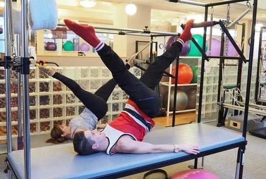 Pilates on fifth man woman reformer stretch