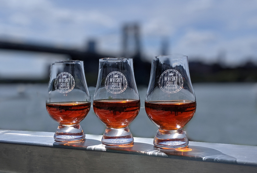 Whiskey guild glasses water river