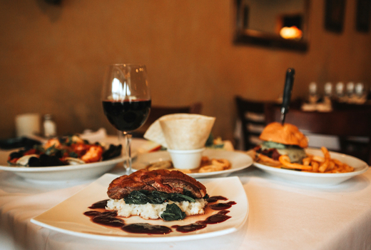 Kaskade dinner steak wine burger table