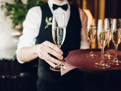 Flute champagne school waiter handing glasses