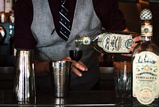 Mezcal pouring bartender